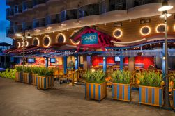 HM, Harmony of the Seas, Sabor Taqueria & Tequila Bar - Deck 6 Aft Portside (Boardwalk), no people, exterior, entrance to restaurant, signage, plants, decor, Mexican cuisine,