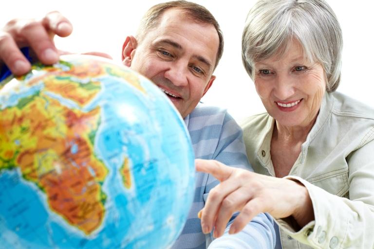 Senior couple looking at globe 1