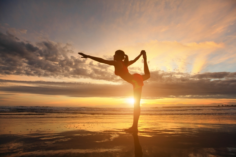 yoga-beach-young-traveler-sunset.jpg