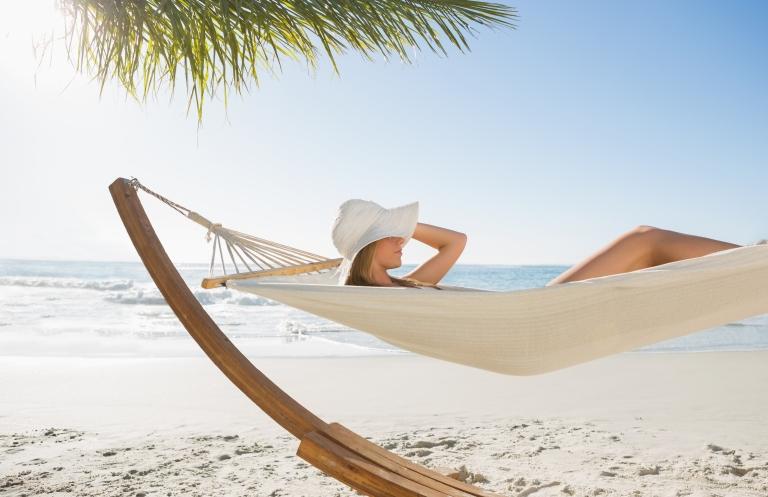 caribbean_woman_in_hammock_hat_beach.jpg