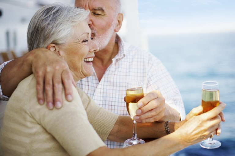 Seniors-on-cruise-deck-with-champagne