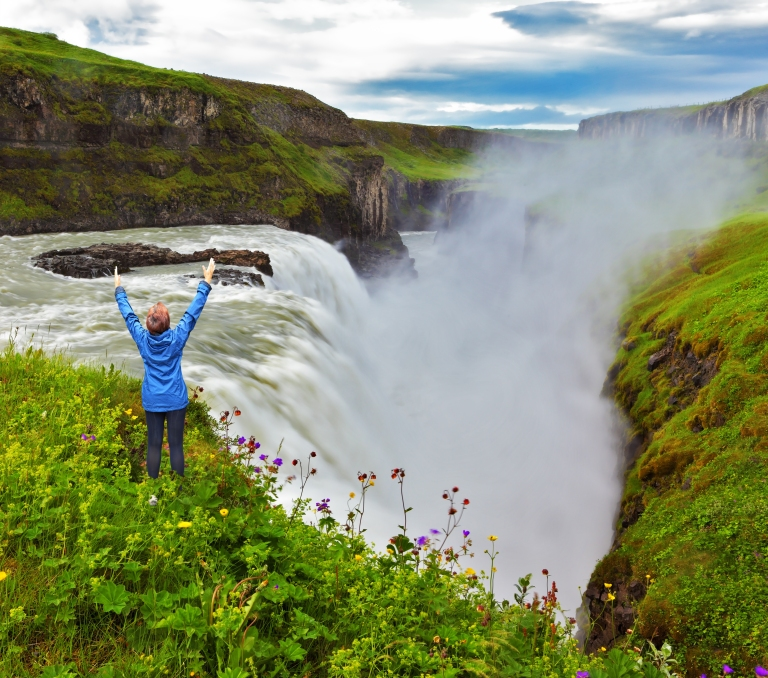 Iceland-Powerful-Gullfoss-in-Iceland-with-woman.jpg