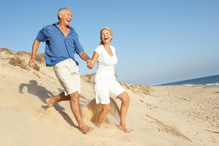 Seniors-running-on-beach-dunes.jpg